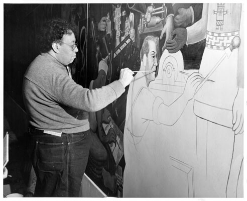 Artist Diego Rivera painting a mural at the Art in Action exhibit of the 1940 Golden Gate International Exposition