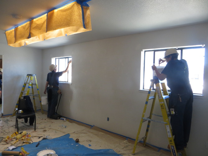 Picture of TI Job Corps BCT students re-painting veterans housing