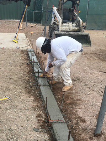 Picture of TI Job Corps Cement students repairing TI Little League Field
